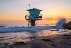 "Life Guard Tower And Waves On Rocks In Encinitas California is a work of fine art that is currently available for purchase at McClean Photography. Art Prints starting at $72.00 on Pearl Fine Art Paper, Canvas, Metal - White Gloss, Wood, 1/4"" Acrylic, Coasters (Set of 4), Wall Mural - Repositionable."