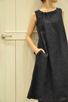 Love the simple lines of this black linen dress.