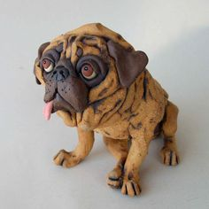 Pugs are among my favorite canine subjects -- love all the wrinkles and folds, the big round eyes and smushed-in face. This one gets a little added character from its sideways pink tongue.    The whimsical sculpture is made from five different colored clay bodies, finished with stains and fired to cone 5. It stands about 6 inches tall by 5 inches wide and 5 inches long. Guaranteed to bring a smile to pug appreciators and dog lovers.