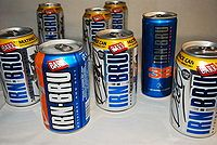 "Irn-Bru is a Scottish carbonated soft drink, for long advertised as ""Scotland's other national drink"" (next to Scotch whisky).[1][2] It is produced in Westfield, Cumbernauld, North Lanarkshire by A.G. Barr of Glasgow, since moving out of their original Parkhead factory in the mid-1990s, & at a 2nd manufacturing site in Mansfield, England. In addition to being sold throughout the United Kingdom, Barr's Irn-Bru is available throughout the world and can usually be purchased where there is a sig"