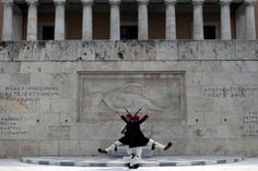 Presidential guards perform during a changing of the guard ceremony, at the tomb of the unknown soldier, in front of parliament in central Athens. Greece celebrated its Independence Day on March 25 which marks Greece's 1821 war of independence against the 400-year Ottoman rule.