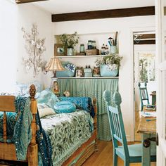 Adding a heavily quilted and pillowed daybed to any room give an instant seating space or a great place to curl up and read a book or take a nap. Love the mix of blue colors here.