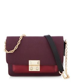 2342446a60 The West 57th Blocked Crossbody is a visually vibrant designer handbag that  will amp up any