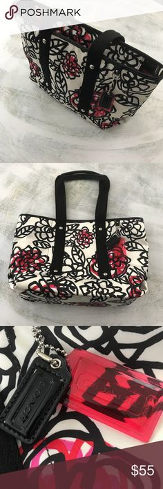 """Coach Poppy Handbag Excellent Used Condition Coach Poppy Handbag in Black and White with pops of red poppies.  Fabric is almost satin like feel.  Handles drop 8"""". Barely used.  Excellent used condition.  I have all 5 star ratings!  You will be delighted with this bag. Coach Bags Shoulder Bags"""
