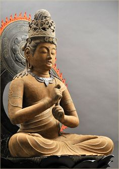 Buddha in the Vajra-Mudra (right index finger is wrapped by left hand).  This Mudra also is called the Bodhyangi-Mudra, the Mudra of Supreme-Wisdom, or the Fist of Wisdom-Mudra. There are multiple interpretations for this Mudra. For example, the right index finger may represent wisdom, hidden by the world of appearances (the left hand).