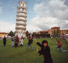 """The Leaning Tower of Pisa (Italian: Torre pendente di Pisa). A popular tourist activity is to pose for photographs pretending to """"hold up"""" the leaning tower and preventing it from falling. The illusion is created through the principle of forced perspective. funny tourists"""