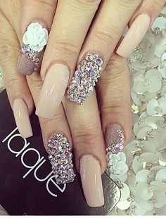 Long nude, glittery taupe nails with Swarovski crystals. Could do without the roses.