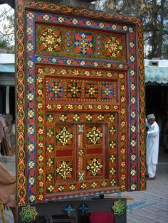 Handcarved and painted wooden frame displayed at Lok Virsa Mela, Islamabad, Pakistan. Lok Virsa Mela is a folk heritage annual event in Spring season in Islamabad, where craftsmen and craftswomen from all provinces of Pakistan gather and display their work and sell their handcrafted artwork of all kinds. There is an 'Artisans at work' segment where artisans show how they produce an artwork. Photography: Zehra Naqavi (Architect/artist). April 11, 2012 All photographs are watermarked.