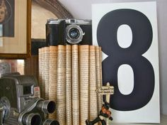Vintage camera display.  I like that it is paired with other antique-style items.