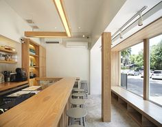 party space design has created a simple white construction for common room cafe in bangkok. Cafe Shop Design, Coffee Shop Interior Design, Small Cafe Design, Interior Design Website, House Design, Bangkok, Simple Cafe, Cafe Concept, Common Room
