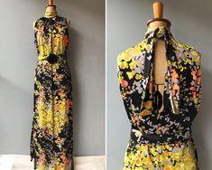 1970s Floral Maxi Dress #70sdress #1970sdress #1970smaxidress #etsy #etsyvintagestore #vintageclothing #vintageclothingaustralia #clothing #dress #floral #bohohippie #sleeveless 1970s Dresses, Floral Maxi Dress, Green And Orange, Simple Dresses, Etsy Vintage, Hippie Boho, Vintage Outfits, Clothing, How To Wear