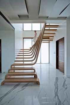 Contemporary wooden staircase. DM APARTMENT Inde Photo Bharath Ramamrutham