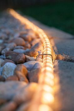 outdoor walkway lights ideas Rope light ideas including walkway lights, landscape lighting and deck lights. Use energy efficient LED rope light for your long term outdoor lighting projects! Outdoor Rope Lights, Outdoor Walkway, Gravel Pathway, Rope Lighting, Led Rope Lights, Outdoor Patios, Deck Patio, Wedding Lighting, Backyard Walkway