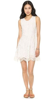 Free People Sparkling Beauty Dress himmering beads accent tonal floral embroidery on a romantic Free People dress. The fit-and-flare silhouette is detailed with scalloped crochet trim. Hidden back zip. Sleeveless. Lined.