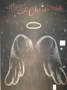 Merry Christmas interactive chalk wall. Just stand in front to be a Christmas Angel.