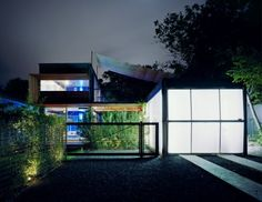Bercy Chen Studio, led by Thomas Bercy and Calvin Chen, have a number of standout projects that push the envelope. While they embrace full-height glass walls, they don't do such without paying attention to shading those walls and the spaces behind from the hot Texas sun. The Annie Residence is a colorful house (note the glowing blue walls in the background) that greets visitors and passersby with a translucent garage door.