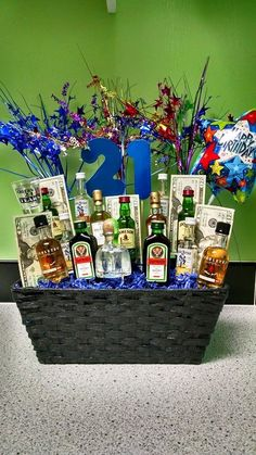 21st birthday gift for my son. I bought mini bottles from the liquor store and hot glued them to bamboo skewers that I broke into different lengths.  The cash is stuck to the skewer with a glue dot so it wouldn't tear when removed.  There is floral foam in the bottom of the basket covered by tissue paper.  Just stick the skewers in.  The heavier bottles should be lowest since they'll topple over or come unglued from the skewer.