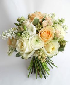 Romantic bridal posy in muted peaches and creams.