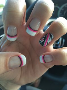 Pink and black gel nails with white tips. French tip. Zebra and flower accent nail. Small twist on old design