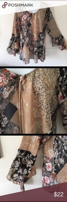 Hokus Pokus boho top Top is just gorgeous! Semi sheer.  Beautiful sleeves and tie in front. Hokus Pokus Tops