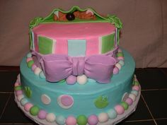 Two peas in a pod cake.  Edible twin baby shower cake
