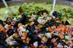 a delicious dish made with fish and rice at Borough Market @ London, UK;  Copyright @arpaboyuyol
