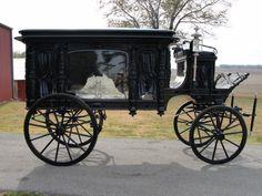 horse drawn hearse. Very ornate!