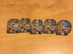 Borealis Aquerple with black pips. $14.99  Makes a great addition to the game or even a souvenir.