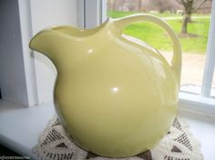 VINTAGE YELLOW SIGNED HALL #633 POTTERY PITCHER WITH ICE CATCHER
