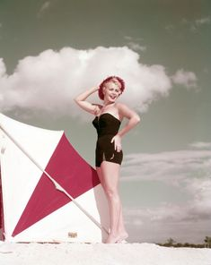 Kathy Daelyn Smith modeling a bathing suit at the beach in 1954. | Florida Memory