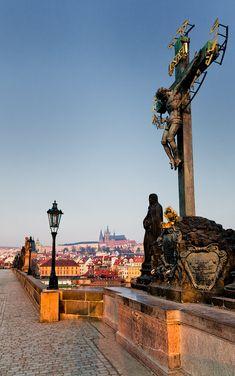 Statues along de Charles Bridge frame de Prague Castle on de opposite bank in Prague, is situated on de Vltava River in Central Bohemia_ Czech Republic