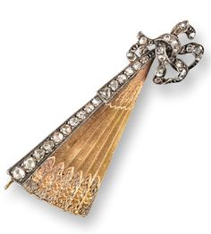 A late Victorian diamond set stylised fan brooch, terminating in a loosely tied bow and set with rose-cut diamonds. 4.5cm long.