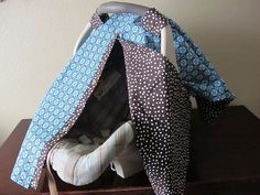 Baby boy car seat cover in blue and brown  by TurnbowDesigns, $38.50