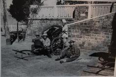 Rickshaw pullers resting. Chowrasta, Darjeeling during the British Raj