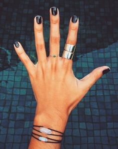 Short, black nails. It's either something really short or dramatic coffin nails. There's no In between