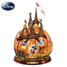 Disney pumpkin centerpiece features 12 favorite characters peeking out of the windows...and Tinker Bell flying at the top!