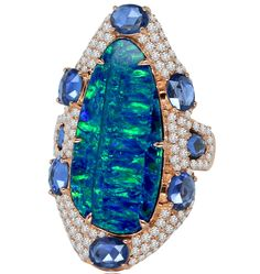 Ring in 18k rose gold with 8 ct. Australian opal, 3 cts. t.w. sapphires, and 4 cts. t.w. diamonds, $7,500; Sutra