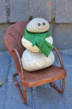 A rock snowman for door stop or front porch! I'd use button eyes, black beads for mouth and a little orange painted, sharpened dowel for nose, twig arms?