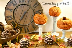 Love these little pumpkins perched on candlesticks Autumn Warmth: Red and Turquoise Fall MantelDIY Show Off ™ – DIY Decorating and Home Improvement Blog