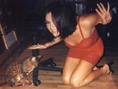 How do you get Spice Girl Victoria Beckham to smile? With a kitty!
