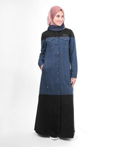 This delightful mixed fabric Jilbab is your statement piece without being loud. With a combination of blue denim and black contrast blocks, this Jilbab is subtle in colour but will make a great impression when you wear it. Grab your statement denim today.