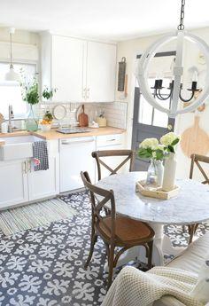 Summer Home Tour Kitchen Updates. White cabinets, painted floor tie
