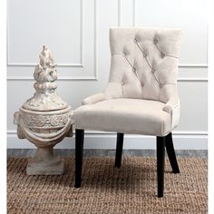 @Overstock.com - Abbyson Living Napa Cream Fabric Tufted Dining Chair - Give your dining room a touch of elegance and classic sophistication with this pretty tufted cream dining chair. This chair features a mid-century design with a wooden frame, and is upholstered with sleek microsuede material for softness and comfort.   http://www.overstock.com/Home-Garden/Abbyson-Living-Napa-Cream-Fabric-Tufted-Dining-Chair/7900994/product.html?CID=214117 $216.99