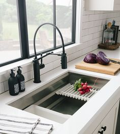 Black faucet finishes are a new classic. Update your faucet and hardware when a full remodel isn't in the budget.