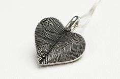 Fingerprint Heart Necklace Personalized Sterling Silver Thumbprint Jewelry  This piece is one of our newest designs in our line of Fingerprint Jewelry. We take your own 2 fingerprints and make a beautiful solid sterling silver necklace. We also include 2 names engraved on the back. This piece is heavy and chunky. An 18inch sterling silver chain is included.  This is a great gift for a wedding, anniversary or any major holiday.Or you may choose to wear a print of a loved one who has passed…