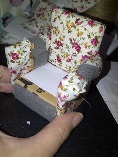 This is Thatch Cottage in the making...   I made a little armchair from old card and some floral fabric, below you can see how I did i...