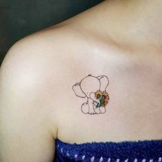 lined elephant tattoo design with sunflowers