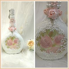 Shabby chic hand decorated wine bottle. It has been painted with old white chalk paint and given a coat of protective wax.  I hand painted the roses and gold relief detail. I added pearl scroll detail over the rest of the bottle. I then added beautiful laces and pearls with rhinestones to add a little sparkle. Mulberry roses have also been added and given a coat of shimmering pearlised mist in a delicate peach colour to match the lace and painted flowers.  Theres lots of pretty tiny pearl…