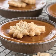 Pumpkin pie recipe - Instead of a rolled-out bottom crust, this crust is cut into pretty shapes and scattered on top of these individual pies.
