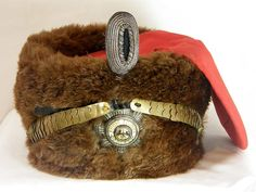 "The Pelzmuetze ( ""busby"" ) of Kaiser Wilhelm II for his Leib Garde Hussar Regiment. This one-of-a-kind piece of Imperial German/Prussian headgear would have been worn by the Emperor ( ""Kaiser"" ) of the Second German Reich ( Wilhelm II ) whenever he visited his personal Hussar bodyguard regiment. The pillbox-shaped ""busby"" is covered in luxurious brown otter fur and has a red wool Kolpak (bag), appropriate for his Leib Garde Hussar Regiment."